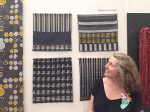 My pieces displayed between Grace's hand-spun hanks and Sarah's printed fabric