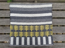 24-shaft double cloth design sample in Shetland wool, plant dye, light reflective yarn with rubber on underside