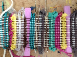 Fabric strips and Mixed Media used in the weft