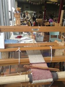 Demonstration of weaving on my folding floor loom.