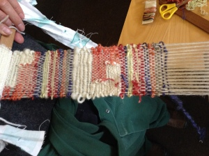 Using a tapestry technique, clasped weft