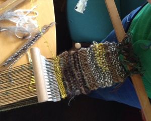 Backstrap weaving using natural fleece colours and plant dyed wool