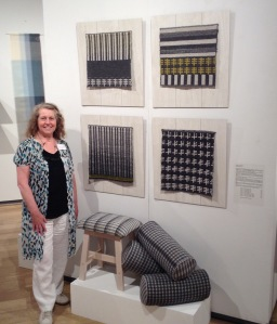 Designer Crafts on the Mall Private View evening - my display of handwoven wool rug samples, upholstery and bolster cushions.